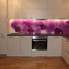 Photo glass with purple orchids